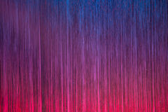Colourful stage curtain. A stage curtain of pink purple and blue with streamers provides a colorful backdrop Stock Images
