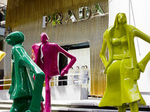 Colourful statues and Prada Store stock image