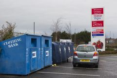 Colourful steel clothing banks for charities located in the local Tesco Extra car park at Newtownards County Down Northern Ireland stock image