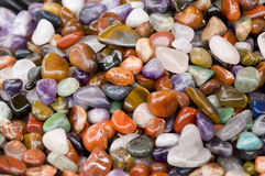Colourful stones. A lot of colourful gemstones Royalty Free Stock Photo