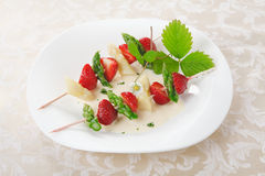 Colourful strawberry and asparagus skewers Stock Image