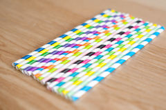 Colourful straws on a table Royalty Free Stock Image