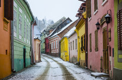 Colourful street in Sighisoara, Romania. Colorful street climbing the fortress hill in the medieval transylvanian town Sighisoara, Romania Royalty Free Stock Images