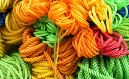 Colourful strings. Put together: yellow, orange, green, blue Royalty Free Stock Photos