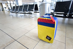 Colourful, striped bag near empty seats in airport departure lounge Royalty Free Stock Image