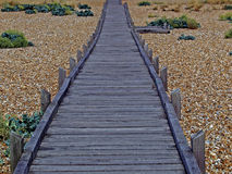 A colourful study of jetty and beach walkway Stock Photos