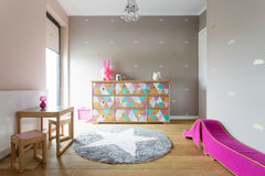 Colourful but stylish decor of a girl's room Stock Photos