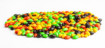 Colourful with sugar. A whole lot of Colourful sweeties with green, red, yellow and black colouring Royalty Free Stock Image