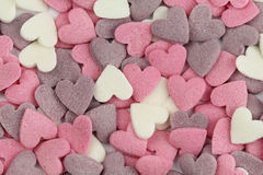 Colourful sugar hearts. Colourful confectionery sugar hearts background for Valentine's Day stock photos