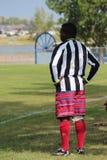 Colourful suknia mężczyzna bawić się futbol Fotografia Stock