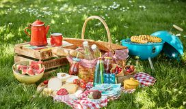 Colourful summer BBQ picnic outdoors in a meadow stock photography