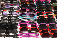 Colourful Sunglasses on Display at Stall Royalty Free Stock Photos