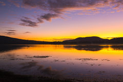 Colourful sunrise at Lake Moogerah in Queensland. Beautifully rich coloured sunrise at Lake Moogerah in Queensland, Australia Stock Photo