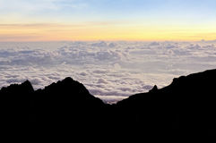 Colourful of sunrise scene with mist on silhouette of mount Kinabalu. Royalty Free Stock Photography