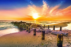 Colourful sunset on a beach Stock Photography