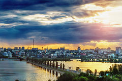 Colourful sunset cityscape. Panoramic aerial view of Chernavsky Bridge from roof top at sunset, Voronezh Stock Image