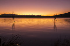 Colourful sunset at Lake Moogerah in Queensland. Beautifully rich coloured sunset on a winters evening at Lake Moogerah in Queensland, Australia Royalty Free Stock Photography