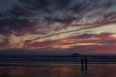 Colourful sunset over the beach at Polzeath Royalty Free Stock Photography