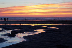 Colourful sunset over the beach at Polzeath Royalty Free Stock Images