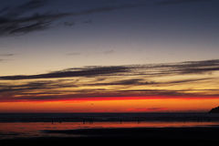 Colourful sunset over the beach at Polzeath Stock Photo
