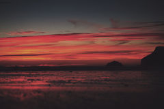 Colourful sunset over the beach at Polzeath Vintage Retro Filter Royalty Free Stock Images