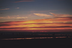 Colourful sunset over the beach at Polzeath Vintage Retro Filter Royalty Free Stock Image