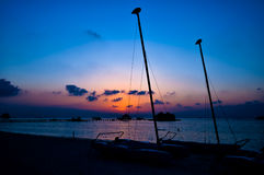 The colourful sunset of sailing boat on the Tropical Beach at Maldives. Colourful sunset of sailing boat on the Tropical Beach at Maldives Stock Images