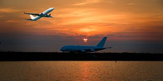 Jet Airliner Flying in an orange coloured cirrostratus cloudy sk. A colourful Sunset Seascape with an airborne passenger jet airliner flying high in the orange stock images