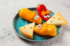 Free Colourful Sweet Mini Peppers In The Shape Of Mouses And Pieces Of Cheese On A Plate, Stone Table, Snack For Kids Idea Royalty Free Stock Images - 161214619