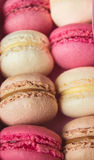 Colourful sweet tasty macaroons macaron in a row pastel Stock Photo