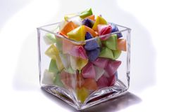 Colourful sweets. Colourful candy from a glass container isolated on a white background Stock Image