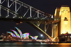 Sydney Opera House and Harbour Bridge towers. Lighted Sydney Harbour Bridge with colourful illuminated Opera House at night (at the Festival of Lights event Stock Photography
