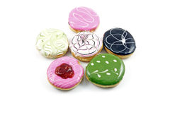 Colourful tasty delicious creamy donut. An image of six colorful designer donut bun served on a white plate stock photos