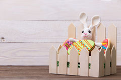Colourful tasty Easter cookies and bunny on white wooden background Stock Photos