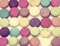 Colourful tasty macaroons in a row. Stock Image