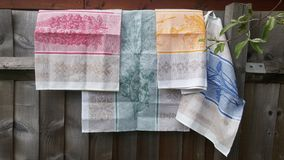 Colourful Teatowels. Colourful tea towels on a wooden fence Royalty Free Stock Image