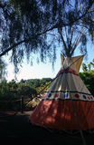 Colourful Tepee. Under the shade of a tree Stock Photos