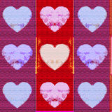 Colourful textured valentine hearts Stock Images