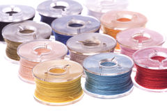 Colourful Thread Bobbins Macro Isolated Stock Photo