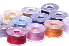 Colourful Thread Bobbins Macro Isolated Stock Photo