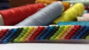 Colourful thread bracelet royalty free stock photography