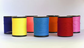 Colourful thread in spool Royalty Free Stock Images