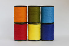 Colourful thread in spool Stock Photos