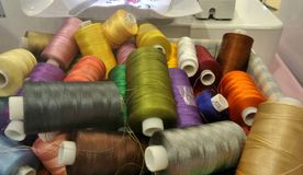 Colourful thread in spools in sewing box Royalty Free Stock Photos