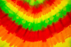 Colourful tie dyed pattern on cotton fabric. For background stock image