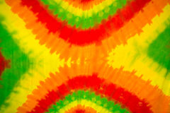 Colourful tie dyed pattern on cotton fabric. For background royalty free stock images