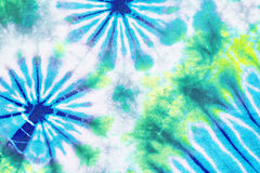 Colourful tie dyed pattern on cotton fabric background. Royalty Free Stock Photos