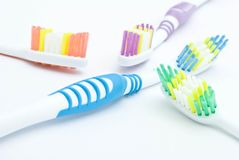 Colourful toothbrushes Stock Photos