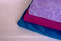 Folded coloful towels. A background of colored folded towels Royalty Free Stock Photography