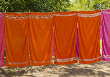 Colourful towels hanging on a rope in the woods Stock Photography